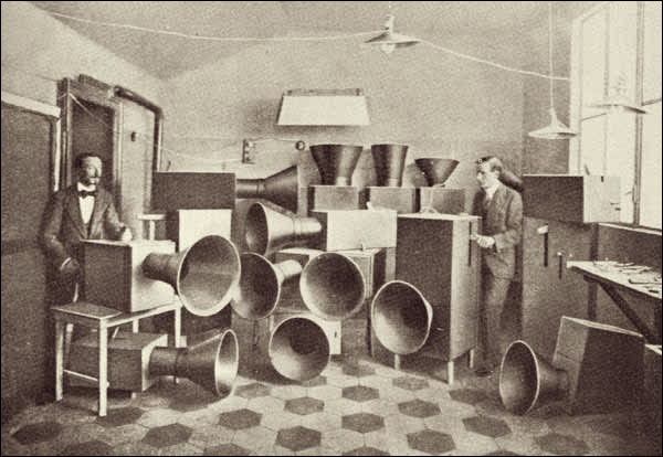 Luigi Russolo (left) and his assistant Ugo Piatti with their 'Intonarumori', 1913 -- 'By selecting, coordinating, and controlling all the noises, we will enrich mankind with a new unsuspected pleasure of the senses.'